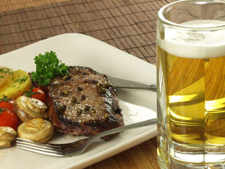 Grilled steak and cold beer photo