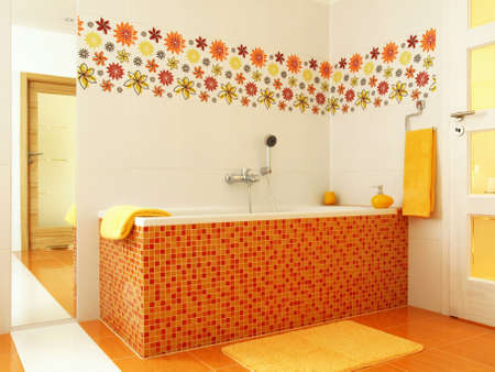 Colorful bathroom with orange mosaic bathtub and yellow towels photo