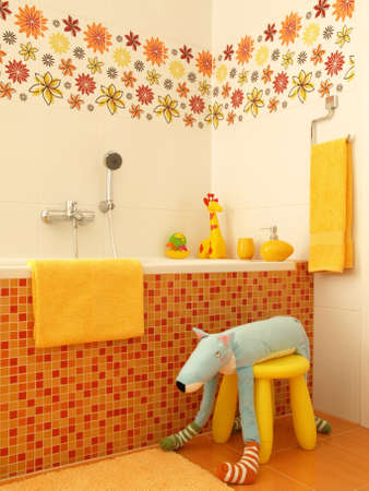 Orange bathroom interior for children photo