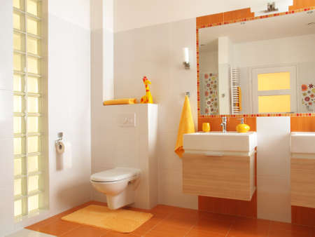 bathroom sink: Friendly bathroom for children with orange tiles and flower decors,