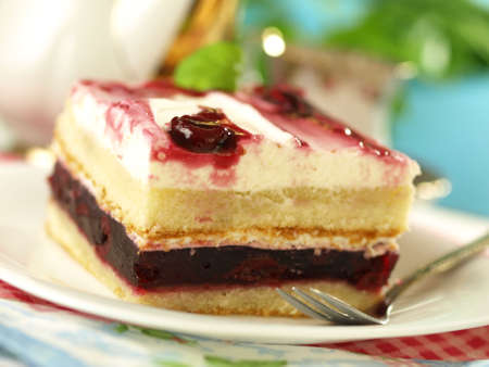 Piece of cake with cherries and whipped cream Stock Photo - 13035057