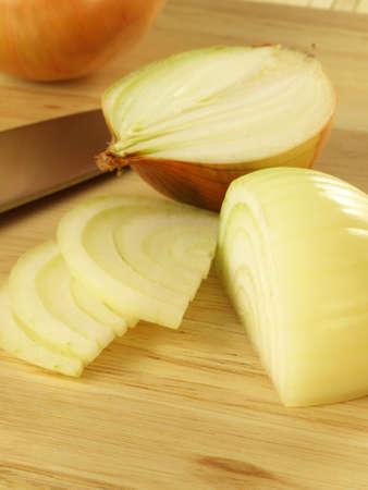 Peeled and sliced onion, closeup photo