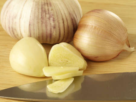 Peeled and sliced cloves of garlic photo