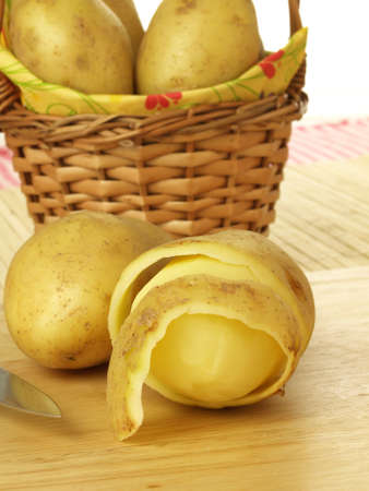 Half peeled potatoes for chips photo
