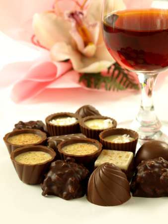 Chocolate pralines and red wine for a dessert photo