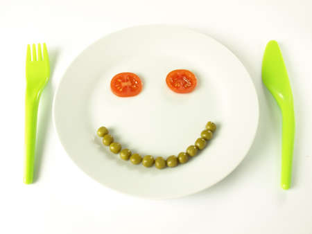 Healthy vegetable smile on a plate photo