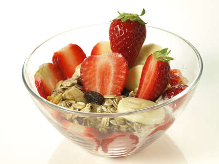 lowfat: Strawberries with delicacies and muesli on isolated background