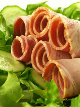 Rolled sirloin with green lettuce and cucumber, closeup Stock Photo - 13056632