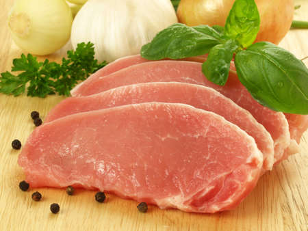 Pork cut in slices with basil, onion and garlic Stock Photo - 13150665