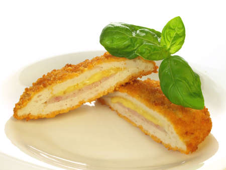 cordon: Breaded cutlet served on a plate on isolated background