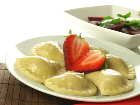 pierogi: Plate with strawberry dumplings and beetroot salad Stock Photo