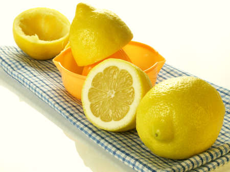 Preparing lemons for squeezing on isolated background photo