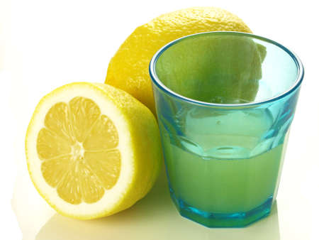 Glass of just squeezed lemon juice on isolated background Stock Photo - 13173887