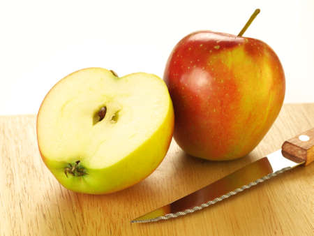 Two apples on cutting boart, on isolated background photo