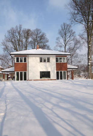 Beautiful modern mansion in cold winter season photo