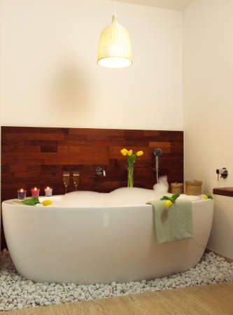 Hot relaxing bath with floral aroma and foam photo