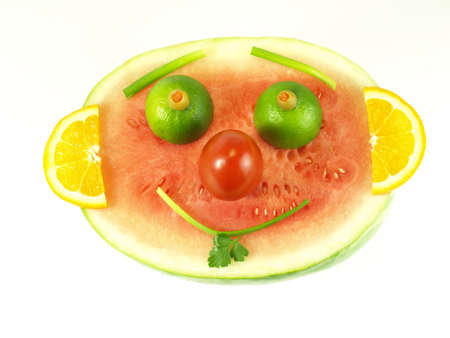 Happy face made with fruits and vegetables on isolated background photo