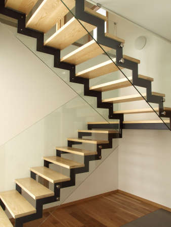 Modern designed stairs made with wood and glass photo