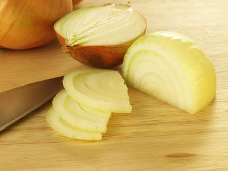 Fresh slices of peeled onion photo