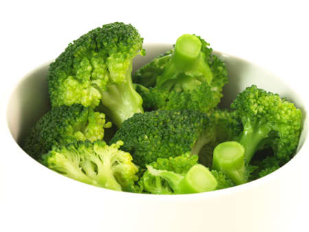 Boiled broccoli in bowl on isolated background photo