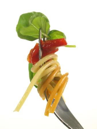 Pasta with sauce and basil on fork, isolated photo