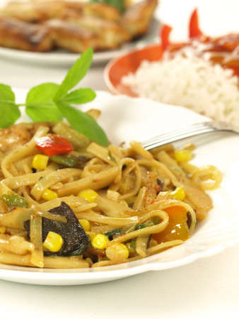 Chinese pasta with vegetables and basil photo