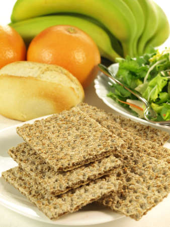 Crispbread, salad and fresh fruits, dietetic food Stock Photo - 13235085