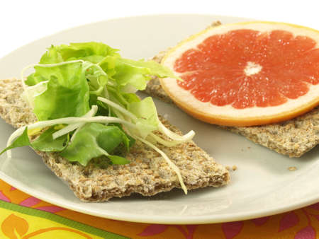 Light sandwiches with lettuce and slice of grapefruit photo