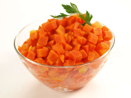Bowl of steamed carrot on isolated background photo