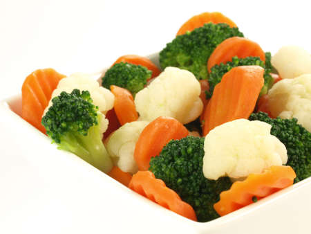 mixed vegetables: Close up of steamed vegetables on isolated background