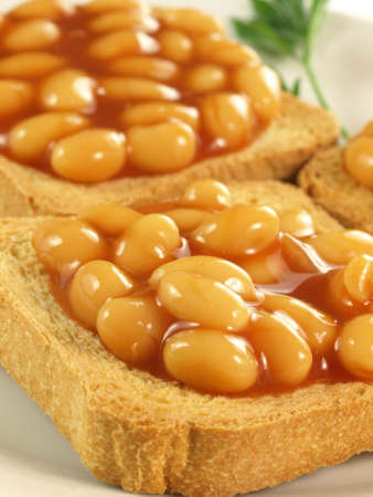 british food: Close up of toasts with baked beans