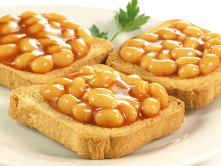 Closeup of beans on toast on isolated background