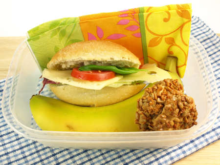 nus: Lunch box with healthy meal and cookies