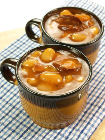 baked beans: Homemade baked beans served in the bowls Stock Photo
