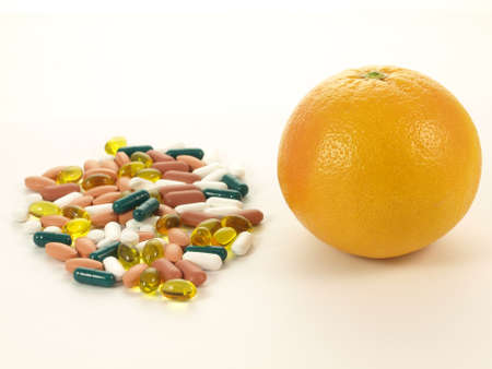Concept shot of choice between two sources of vitamins  drugs and fruits Stock Photo - 13277642