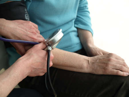 geriatric care: Measurement of blood pressure in the hospital Stock Photo