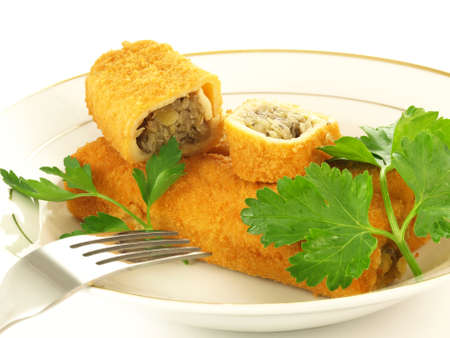 champignons: Croquette with cabbage and muschrooms on a plate Stock Photo
