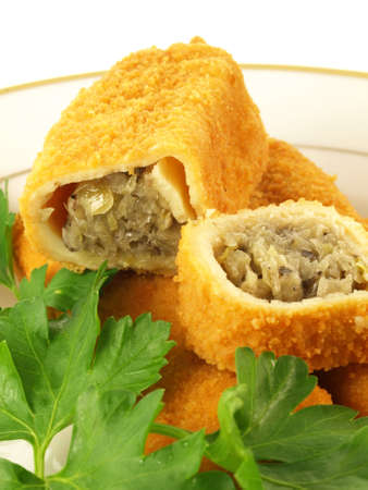 champignons: Closeup of croquette with cabbage and muschrooms