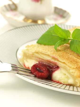 Raspberry crunchy strudel for a dessert, closeup photo
