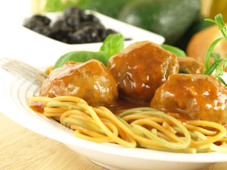 Italian spaghetti with delicious meatballs photo