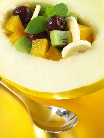 Fruit dessert in melon, closeup photo