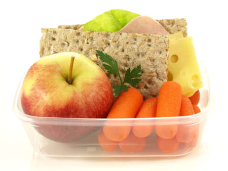 Plastic lunch box with fruits and vegetables photo