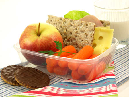 Tasty lunch in lunchbox on isolated background photo