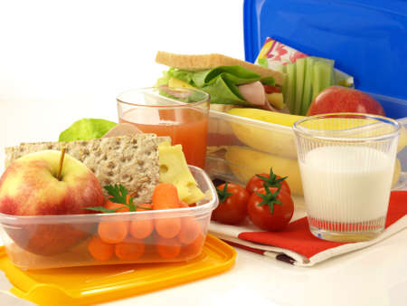 Two lunch boxes with lunch portions and drinks photo
