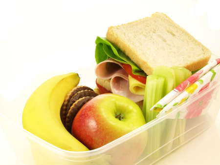 Healthy lunch served in lunch box on isolated background photo