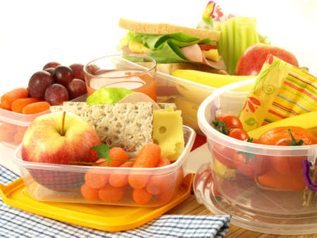 Lunch with various fruits and vegetables in boxes photo