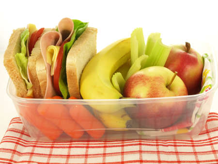 Plastic box with sandwiches and vegetables on a napkin Stock Photo - 13360679