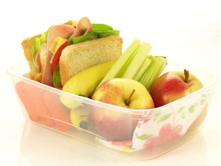 Takeaway breakfast in plastic box on isolated background photo