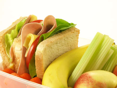 Nutrient sandwich, vegetables and fruits on isolated background photo