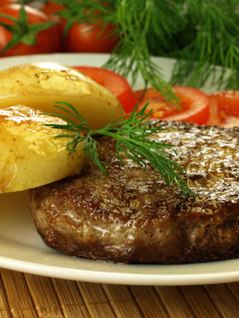 Cutlet, potatoes and tomatoes with green dill in a background Stock Photo - 13390082